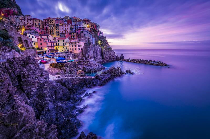 Italy cinque terre manorola by sunrise long exposure stock photography