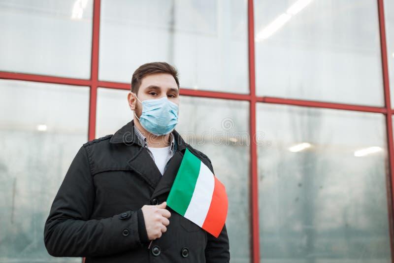 Italy coronavirus spreading outbreak. Man in medical mask, protective mask with Italian flag. Virus epidemic, Chinese coronavirusm. Outbreak influenza. Air royalty free stock photos