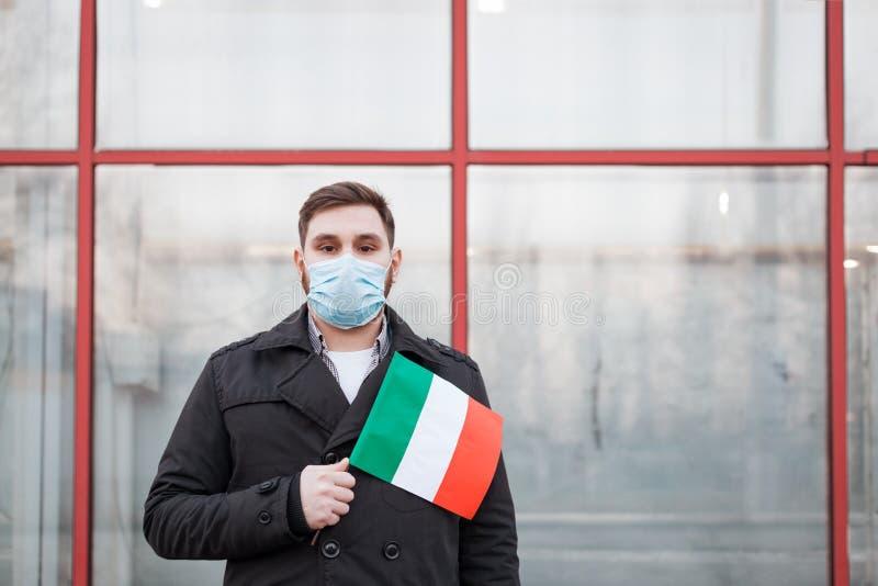 Italy coronavirus spreading outbreak. Man in medical mask, protective mask with Italian flag. Virus epidemic, Chinese coronavirusm. Outbreak influenza. Air stock images