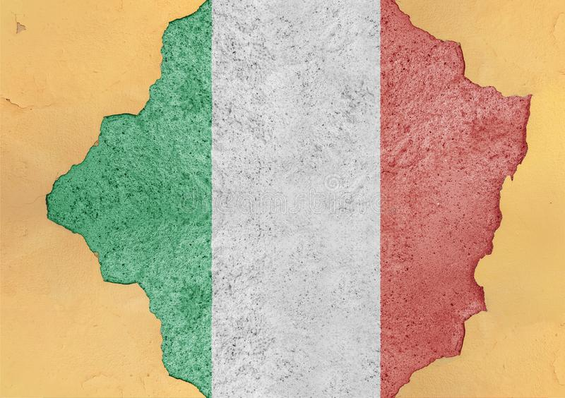 Italy cracked hole and broken flag in big concrete material facade. Structure stock images