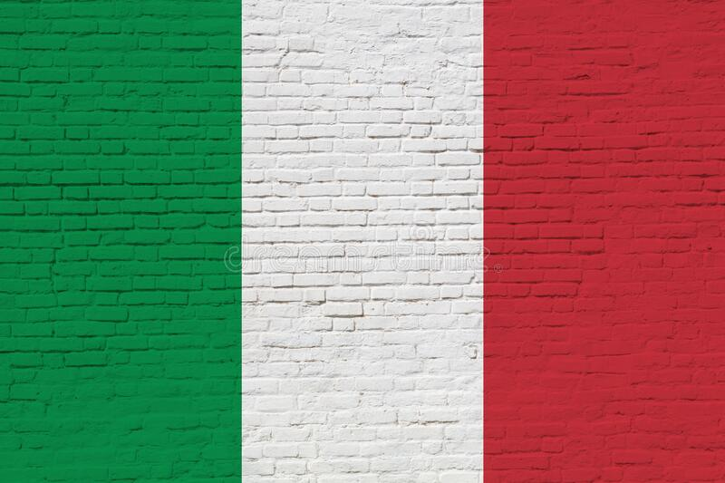 Italy flag painted on brick wall. National Italy flag painted on a brick wall close up royalty free stock photos