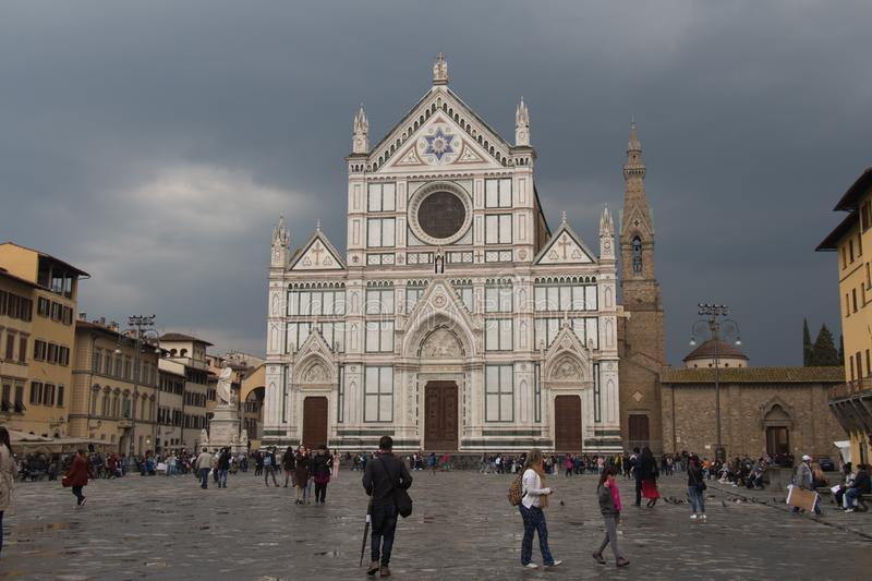 Facade of Basilica Santa Croce with rainy clouds on background. Florence, Tuscany, Italy stock photo