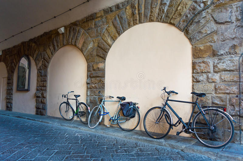 Italy Florence bicycle against the wall stock photography
