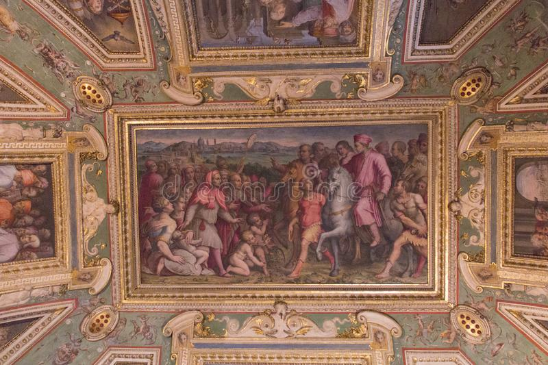 Decorated ceiling of the Sala di Cosimo il Vecchio at medieval Palazzo Vecchio, Florence, Italy. Italy, Florence - May 18 2017: the detailed view of the ceiling royalty free stock images