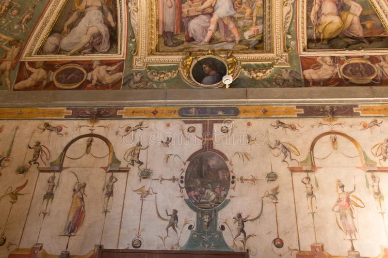 Wall paintings of the Sala di Cosimo il Vecchio at medieval Palazzo Vecchio, Florence, Italy. Italy, Florence - May 18 2017: the detailed view of the wall stock photography