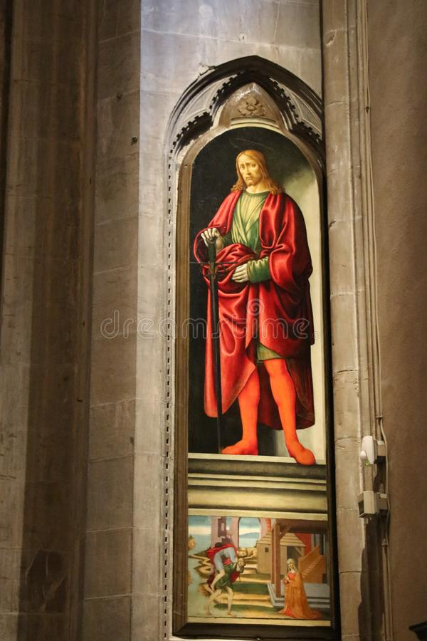 Painting San Giuliano by Francesco Botticini and Jacopo del Sellaio in Orsanmichele Church. Florence, Italy stock photo