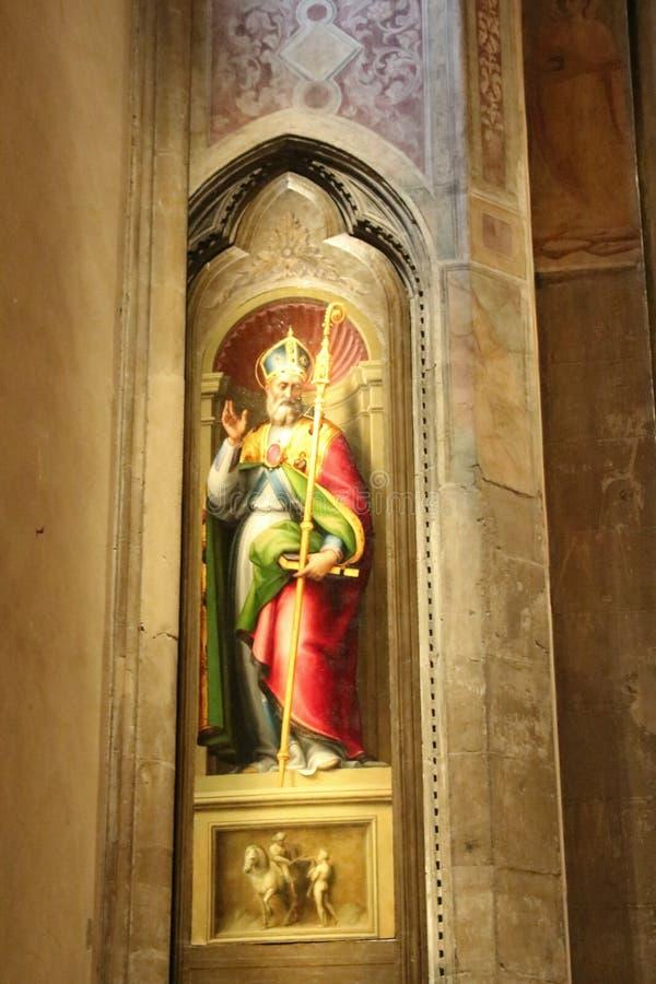 Painting San Martino by Giovanni Antonio Sogliani in Orsanmichele Church. Florence, Italy royalty free stock photos