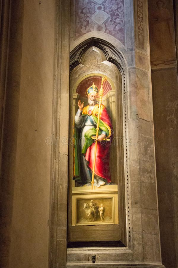 Painting San Martino by Giovanni Antonio Sogliani in Orsanmichele Church. Florence, Italy royalty free stock image