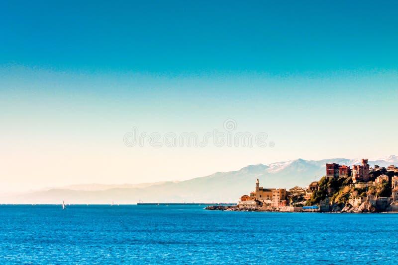 Italy, Genoa`a landmark Boccadasse winter time. Italy Genoa landmark Boccadasse architecture, view from seaside royalty free stock photos