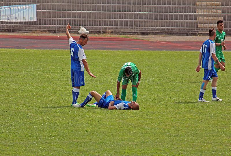 Italy injured player. A injured player in the deaf football world cup match italy vs iraq played at eboli in italy stock image