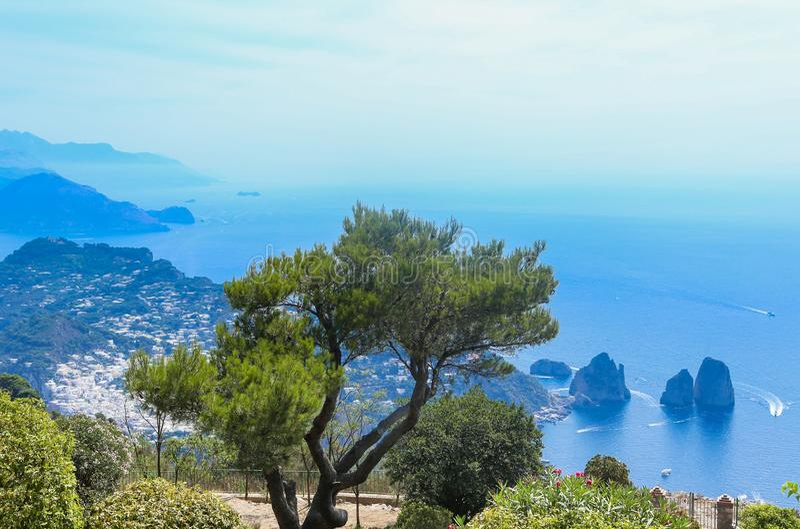 Italy. Island Capri. Faraglioni rocks and boats from Monte Solaro stock photography
