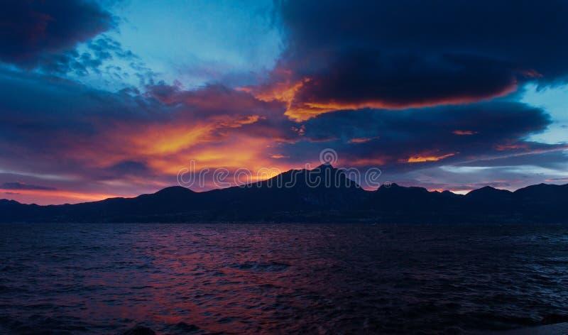 Italy, Lake Garda - Beautiful Sunset Over the Mountains Across The Lake stock image