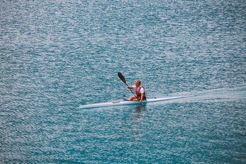 Italy Lake Lago di Ledro July 16, 2013. Female athlete engaged in kayak rowing stock photo