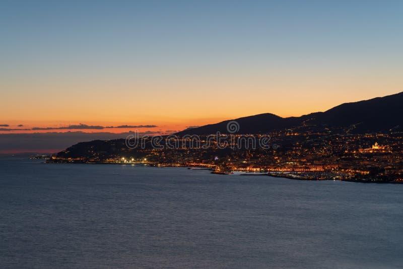 Coast of Sanremo in the evening light, Liguria, Italy. Italy. Ligurian coastline along Sanremo city at evening light stock image