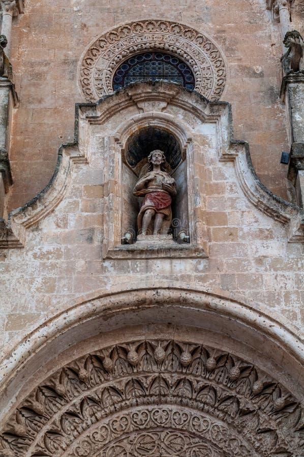 Italy. Matera. Church of St John the Baptist, 13th century. Detail. Polychrome stone statue of St. John the Baptist stock image
