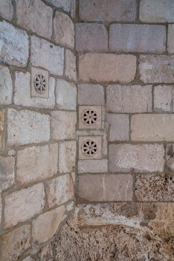 Italy. Matera. Rioni Sassi. Spontaneous architecture. Perforated decorations made to conceal the air intake of an underground room. UNESCO World Heritage site royalty free stock photography