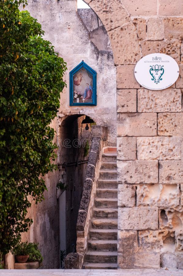 Italy. Matera. The Sassi. Tipical old houses with external staircase and niche with sacred image stock photos