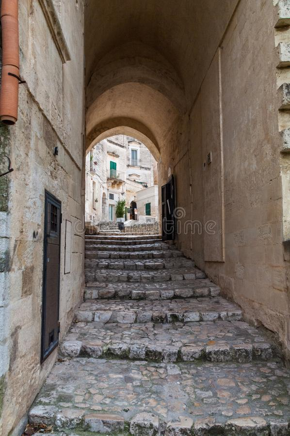 Italy. Matera. Sasso Barisano. Covered public paved stairway between the ancient houses stock photography