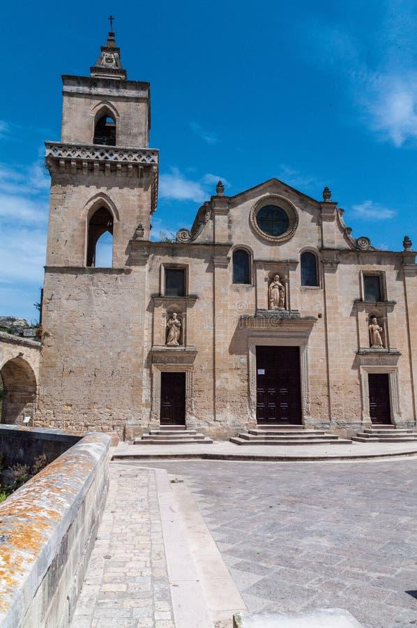 Italy. Matera. Sasso Caveoso. Church of San Pietro Caveoso, 13th century. Main facade and bell tower stock image