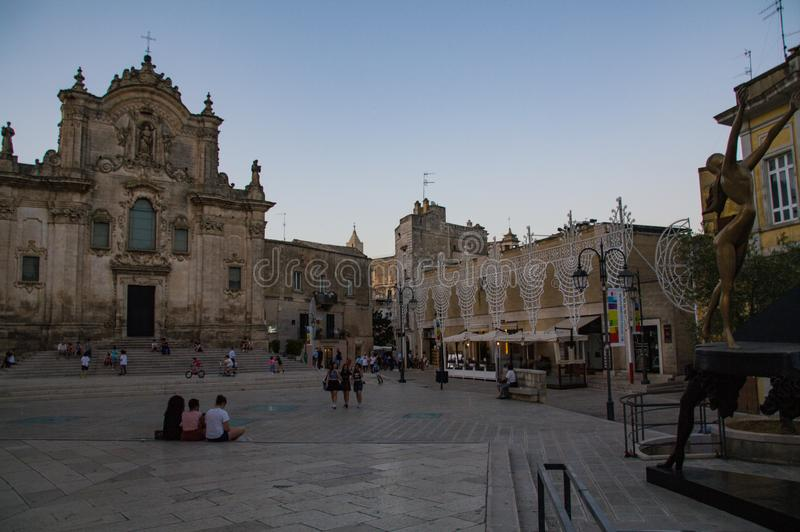 Italy. Matera, Unesco site and European Capital of Culture 2019. Square San Francesco d`Assisi after the sunset. Italy.  matera, unesco site and european capital stock photos