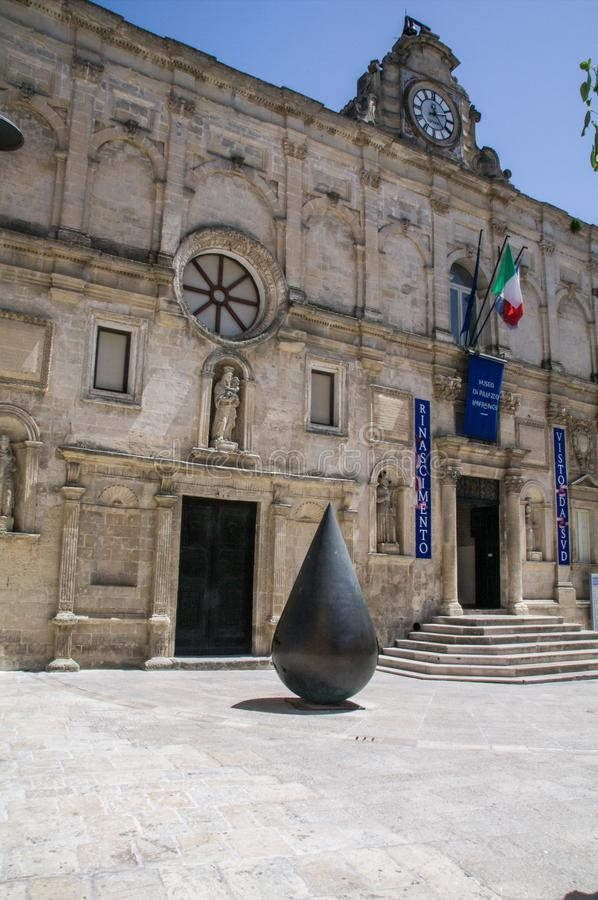 Italy.  Matera, UNESCO site and European Capital of Culture 2019. Urban art. La Goccia, MU 765 G, a large bronze sculpture installed in front of the historic royalty free stock photos