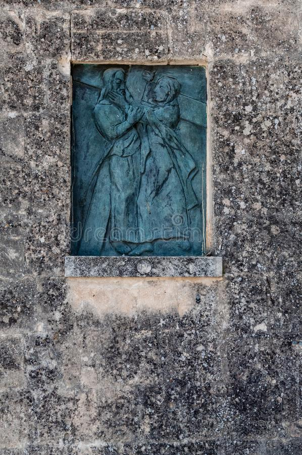 Italy. Matera. Via Crucis in the Sassi. 4th Station, Jesus meets Mary his mother. Bronze tile by Tito, as Ferdinando Amodei, 2004 stock photography