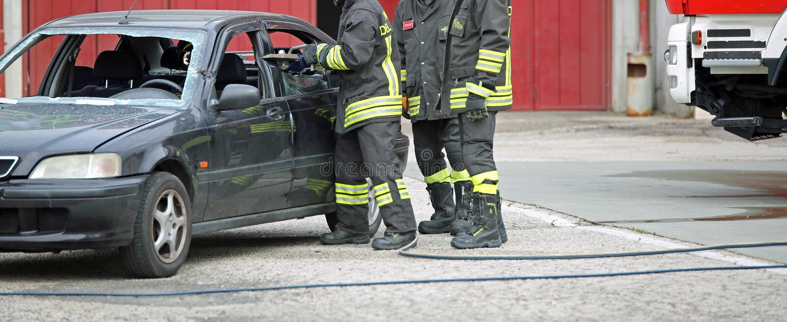 Italy - May 10, 2018: Italian firefighters use the shears to cut. Italy - May 10, 2018: Italian firemen use the shears to free the injured on the car after the stock photo
