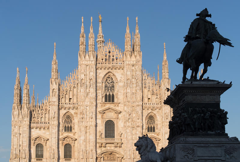 Italy, Milan, Cathedral with equestrian statue Vittorio Emanuele II in the evening light royalty free stock image