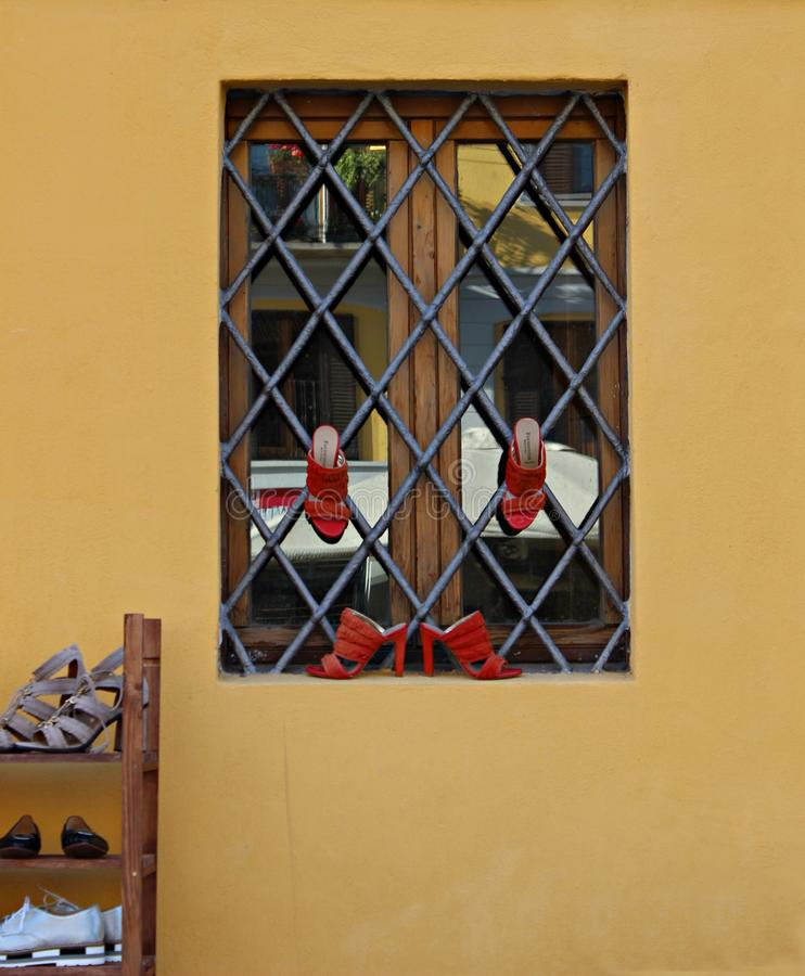Italy, Milan: Red Shoes to the window. royalty free stock photography
