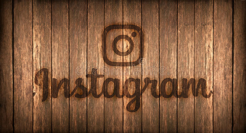 Italy, november 2016 - Instagram logo printed on fire on a wood stock photography