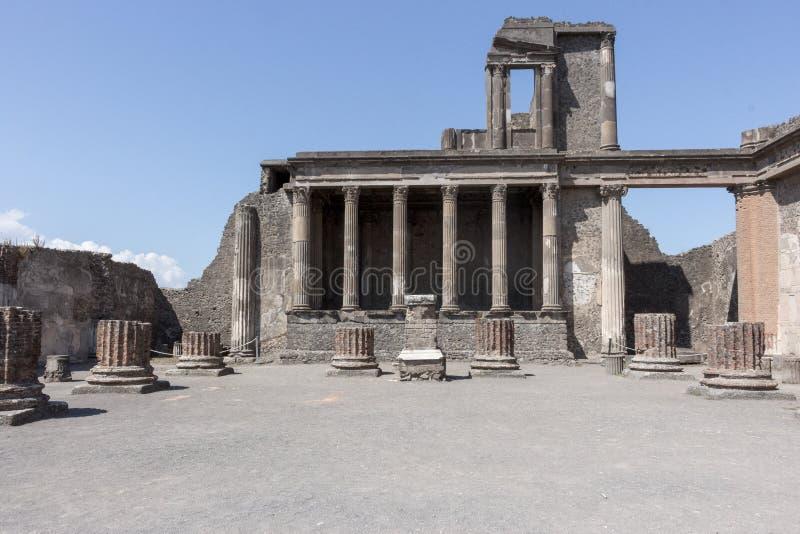 Ancient square forum with columns in Pompeii, Italy. Antique culture concept. Antique roman sculpture and architecture. stock photo