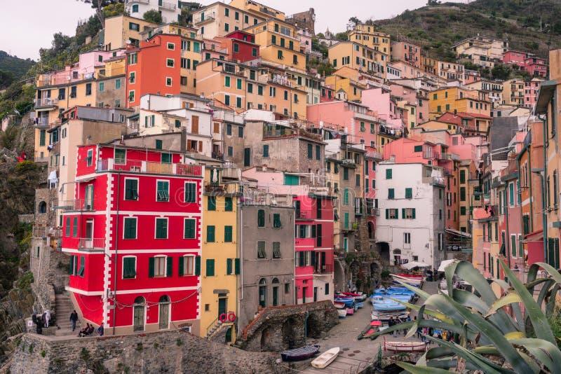 Italy, Riomaggiore – 13 April 2019: view of Riomaggiore roofs and the sea, Cinque Terre, Liguria royalty free stock photo