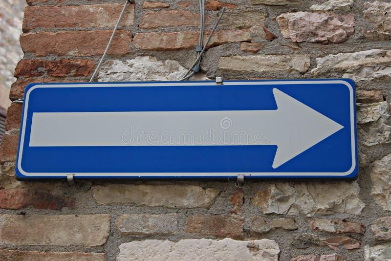 Italy: Road Signal mandatory direction. Italy, Umbria: Road Signal Arrow for mandatory direction royalty free stock photo