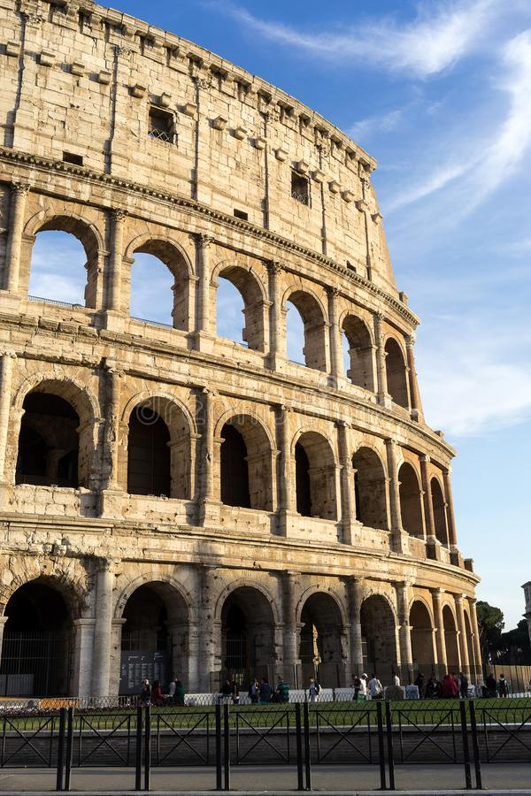 Italy Rome The Colosseum at daytime. Italy Rome a detail of The Colosseum at daytime lit by sunlight royalty free stock photos