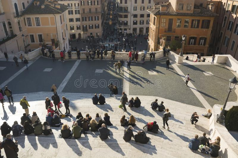 Italy, Rome - December 10, 2018. Crowd of people sitting on city stairs at square of Spain back behind top view. Concept stock photos