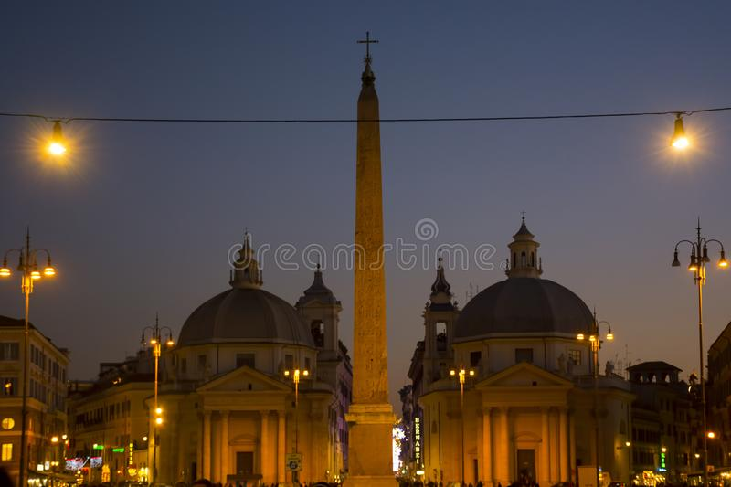 Italy, Rome - December 10, 2018. People`s Square - Piazza del Popolo - night view. Church of Santa Maria dei Miracoli. And Basilica of Santa Maria in Montesanto royalty free stock photos