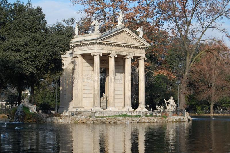 Italy, Rome, lake in the park. Italy, Christmas in Rome, lake in the park. Imitation of the antique temple and statues stock photos