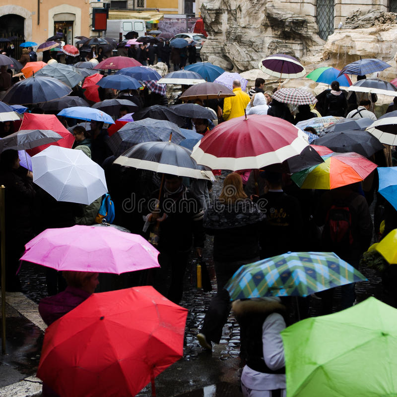 Free Italy, Rome - September 2016: Crowd With Umbrellas Is Standing Near Trevi Fountain. Royalty Free Stock Photography - 86159907