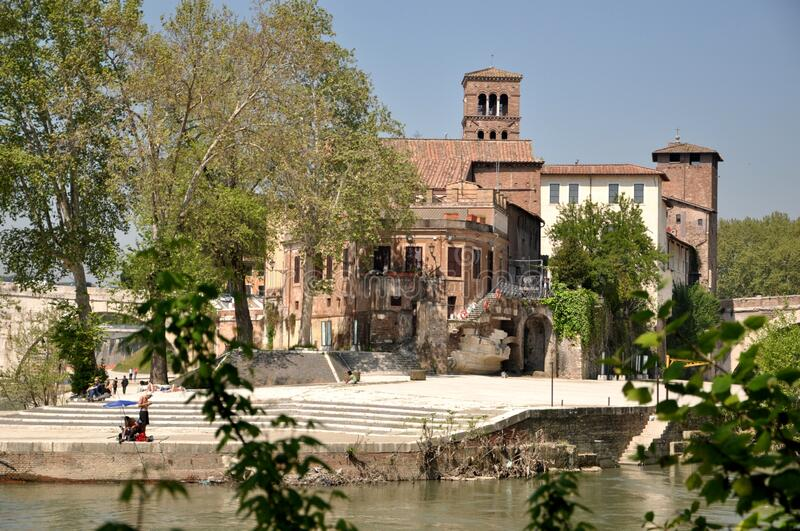 Italy, Rome. The Tiber Island. Panoramic view of the island with the Ponte Cestio. June 2018 royalty free stock photos