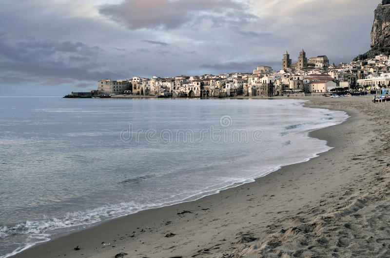 Italy, Sicily, Cefalu. View of the historic town of Cefalu in Sicily from the beach royalty free stock photo