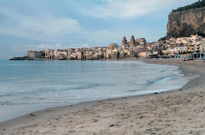 Italy, Sicily, Cefalu. View of the historic town of Cefalu in Sicily from the beach stock photos