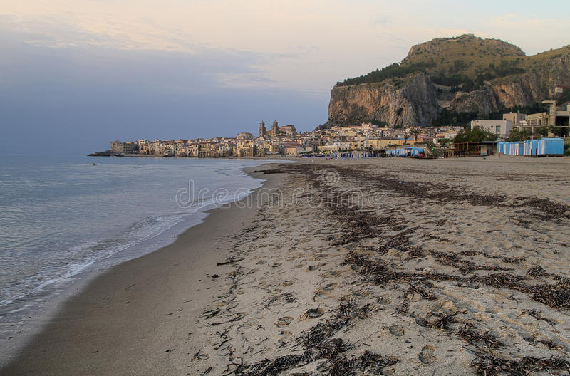 Italy, Sicily, Cefalu. View of the historic town of Cefalu in Sicily from the beach royalty free stock images