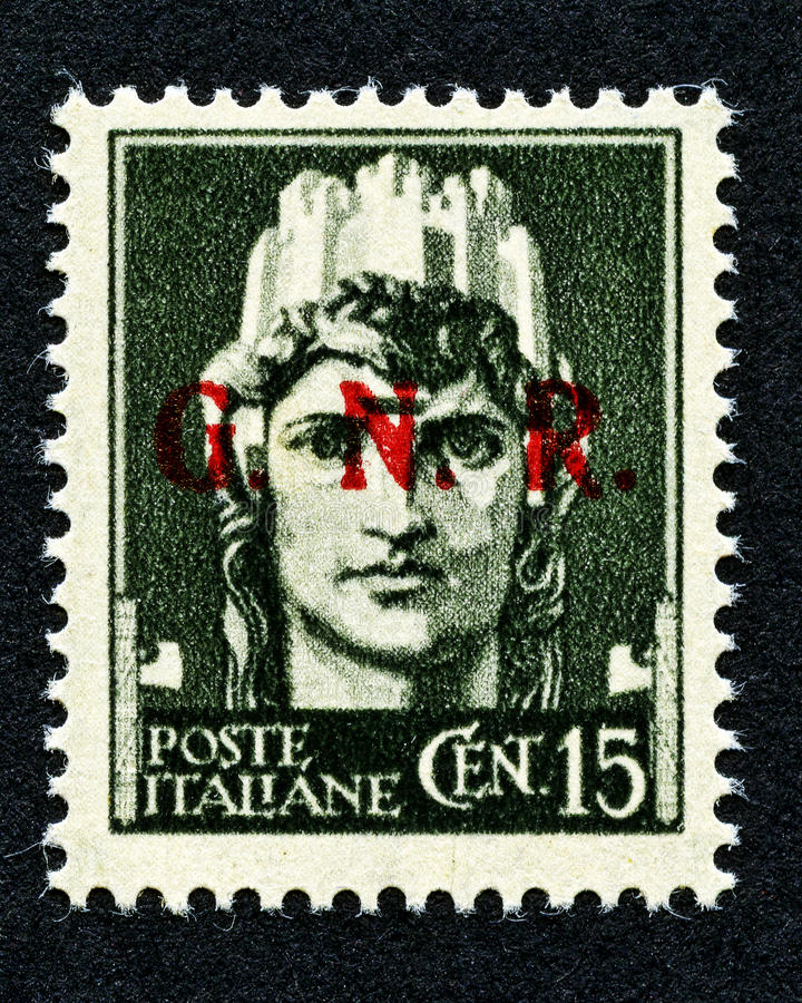 1943 Italy stamp: 15 Cent. overprint GNR. Old retro stamp stock photos