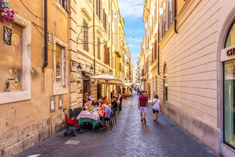 Italy street cafe in Rome street Via delle Carrozze near the Chanel boutique royalty free stock photo