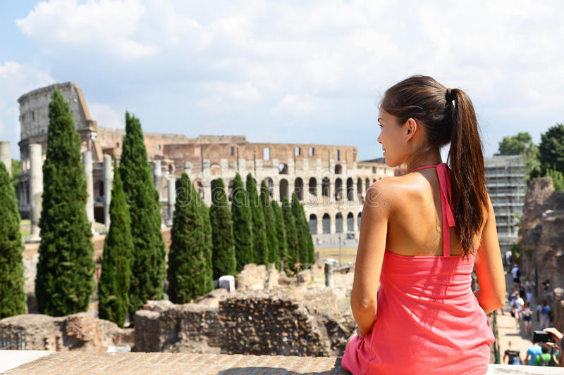 Italy travel - Woman tourist at Coliseum, Rome. Young Asian adult looking at historic landmark touristic attraction in Roma during Italian vacations stock images