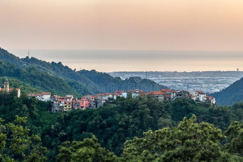 Italy. Tuscany. Colorful view to Massa city. Italy. Tuscany. Colorful summer evening view to Massa city, small village on the hill and sea from the mountains royalty free stock photos