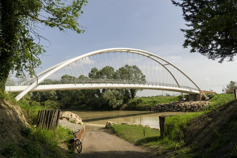 Italy Tuscany Grosseto maremma, new pedestrian cycle bridge over the Ombrone river. Tuscany Grosseto maremma, new pedestrian cycle bridge over the Ombrone river royalty free stock photo