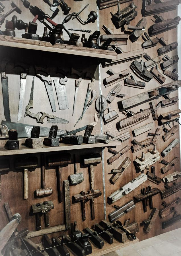 Old carpenter`s tools, on display, inside the Minucciano museum stock photo