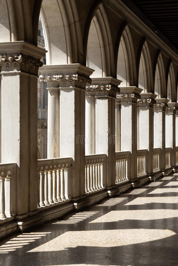 Italy / Venice - 09-08-2017. The arches of the columns of the gallery of the Doge`s Palace in Venice.  stock photos