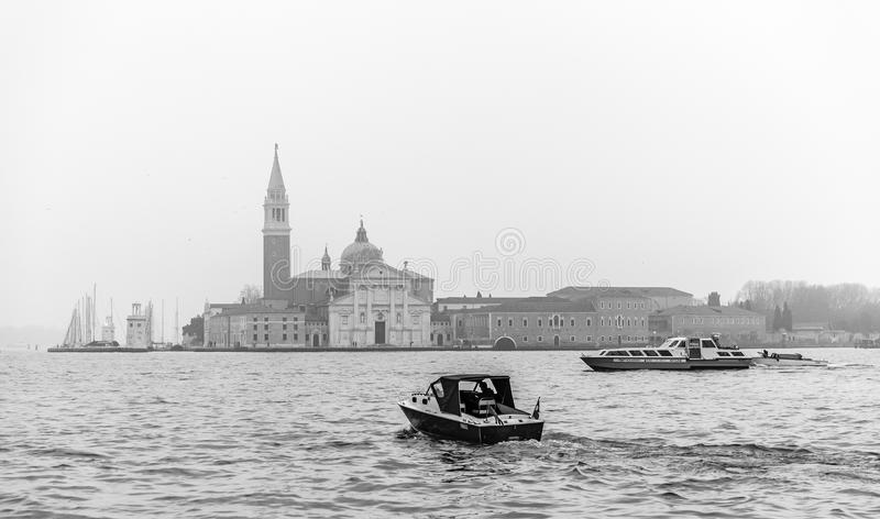 Italy; Venice, 24.02.2017. Black and white photo with boats, riv stock image